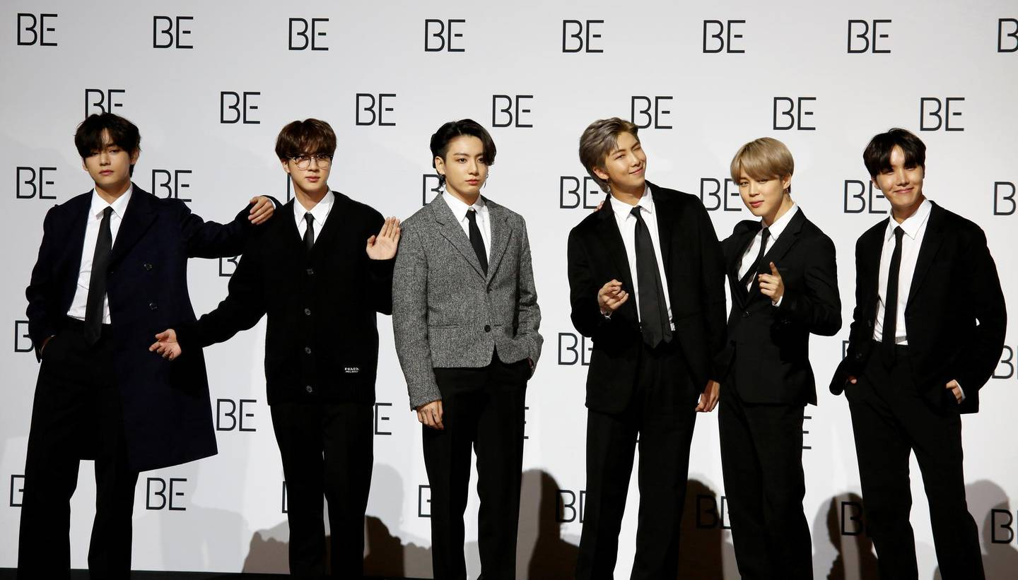 """FILE PHOTO: Members of K-pop boy band BTS pose for photographs during a news conference promoting their new album """"BE(Deluxe Edition)"""" in Seoul, South Korea, November 20, 2020.  REUTERS/Heo Ran/File Photo"""
