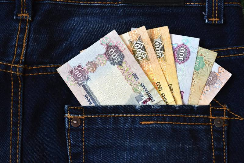 The United Arab Emirates Dirham (Emirati Dirham) currency notes in the Jeans back pocket represents the Income, Cash flow etc. Getty Images