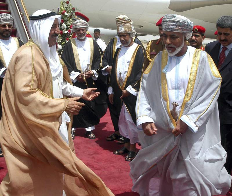 Kuwaiti Prime Minister Sheikh Sabah al-Ahmad al-Sabah (L) welcomes Sultan Qaboos bin Saeed of Oman (R) upon his arrival to Kuwait City 07 June 2005 for a three-day official visit to the state. Qaboos will hold official talks with His Highness the Prime Minister Sheikh Sabah Al-Ahmad Al-Jaber Al-Sabah.  AFP PHOTO/YASSER AL-ZAYYAT (Photo by YASSER AL-ZAYYAT / AFP)