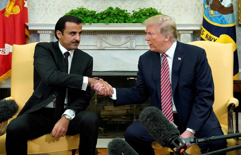 FILE PHOTO: U.S. President Donald Trump meets Qatar's Emir Sheikh Tamim bin Hamad al-Thani in the Oval Office at the White House in Washington, DC, U.S., April 10, 2018.  REUTERS/Kevin Lamarque/File Photo