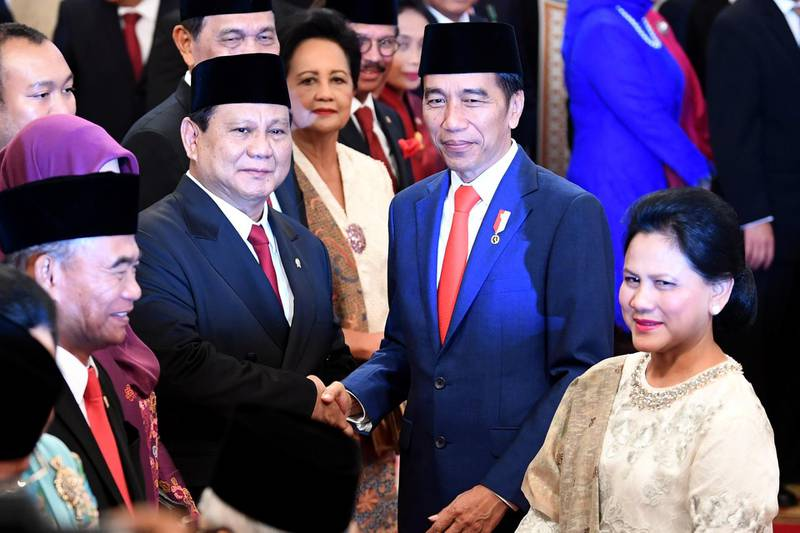 Indonesian Defense Minister Prabowo Subianto is congratulated by Indonesian President Joko Widodo, as First Lady Iriana Widodo stands next to them, after the swearing-in ceremony during the inauguration at the Presidential Palace in Jakarta, Indonesia, October 23, 2019 in this photo taken by Antara Foto.  Antara Foto/Wahyu Putro A/ via REUTERS  ATTENTION EDITORS - THIS IMAGE WAS PROVIDED BY A THIRD PARTY. MANDATORY CREDIT. INDONESIA OUT.