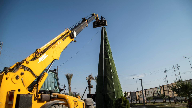 Setting up a Christmas tree outside the town of Hamdaniya, Mosul. Haider Husseini / The National