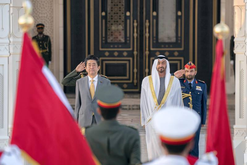 ABU DHABI, UNITED ARAB EMIRATES - January 13, 2020: HH Sheikh Mohamed bin Zayed Al Nahyan, Crown Prince of Abu Dhabi and Deputy Supreme Commander of the UAE Armed Forces (R) and HE Shinzo Abe, Prime Minister of Japan (L), stand for the national anthem during a reception at Qasr Al Watan.  ( Eissa Al Hammadi for the Ministry of Presidential Affairs ) ---