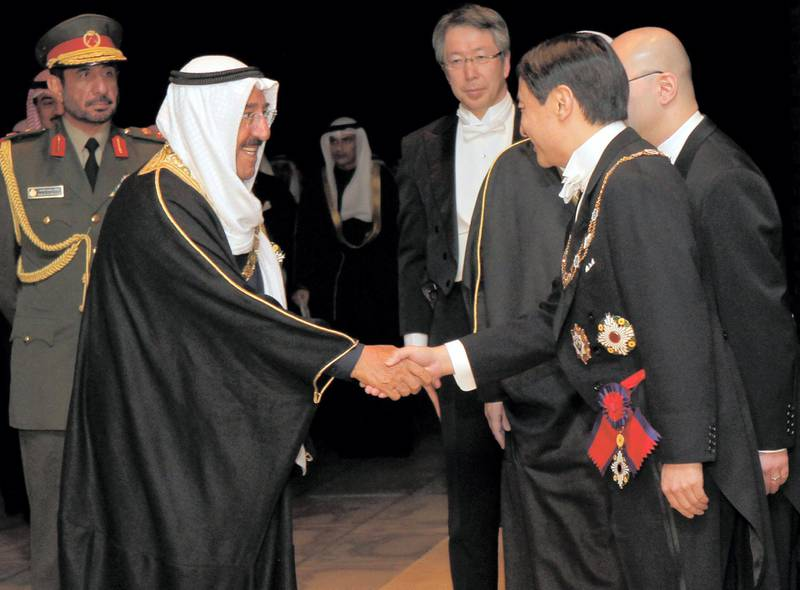 The Amir of Kuwait Sheikh Sabah Al-Ahmad Al-Jaber Al-Sabah is welcomed by Crown Prince Naruhito (R) prior to their official dinner at the Imperial Palace in Tokyo March 21, 2012. REUTERS/Itsuo Inouye/Pool (JAPAN - Tags: POLITICS ROYALS)