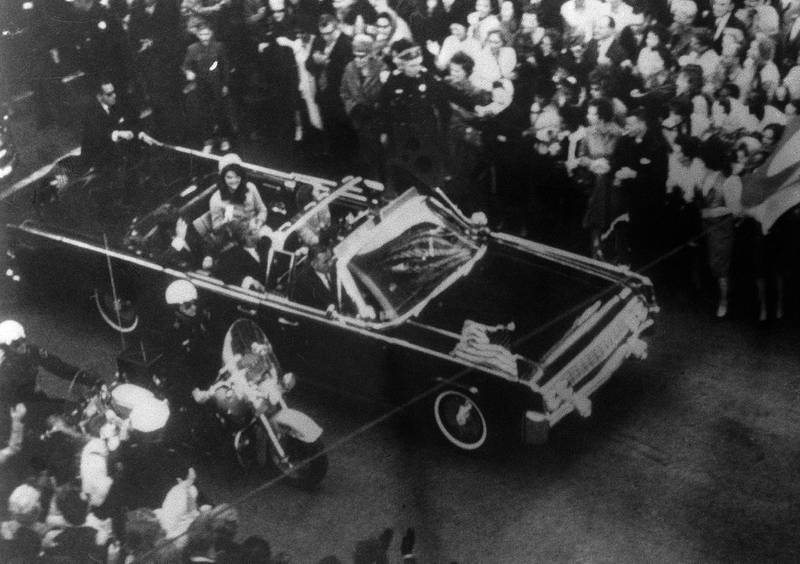 This image provided by the Warren Commission is  an overhead view of President John F. Kennedy's car in Dallas motorcade on Nov. 22, 1963, and was the commission's Exhibit No. 698. Special agent Clinton J. Hill is shown riding atop the rear of the limousine. President Donald Trump is caught in a push-pull on new details of Kennedy's assassination, jammed between students of the killing who want every scrap of information and intelligence agencies that are said to be counseling restraint. Some 2,800 other files on the assassination have now been made public, and they capture the frantic days following the Nov. 22, 1963 assassination.(Warren Commission via AP)