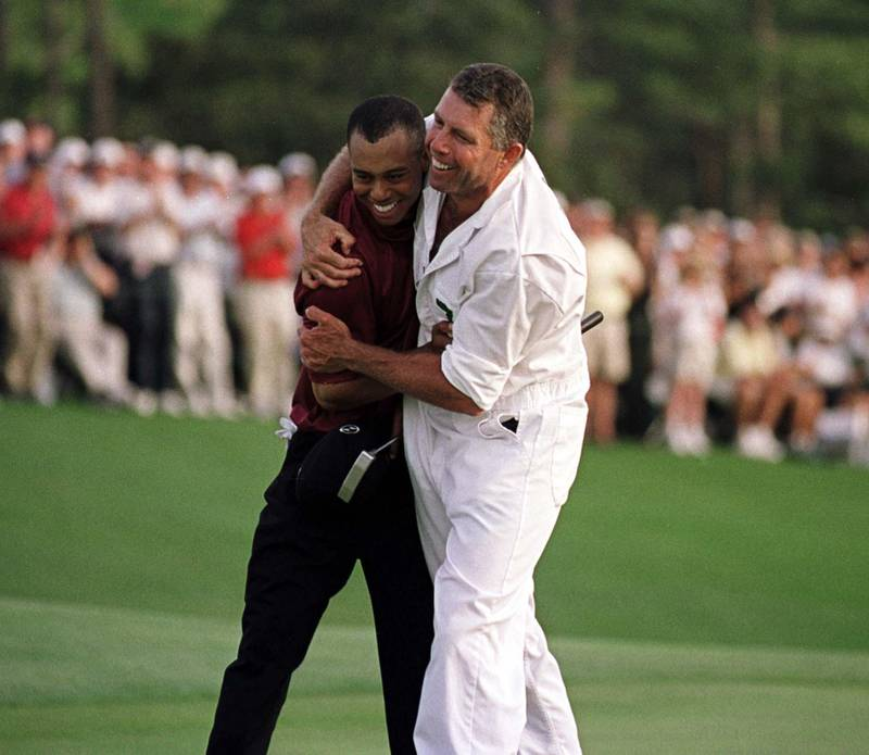 8 Apr 2001:  Tiger Woods of the USA celebrates with his caddie Steve Williams after winning the Masters on the 18th green during the final day of the 2001 Masters at the Augusta National Golf Club, Augusta, GA, USA. Mandatory Credit: Stephen Munday/ALLSPORT/Getty Images