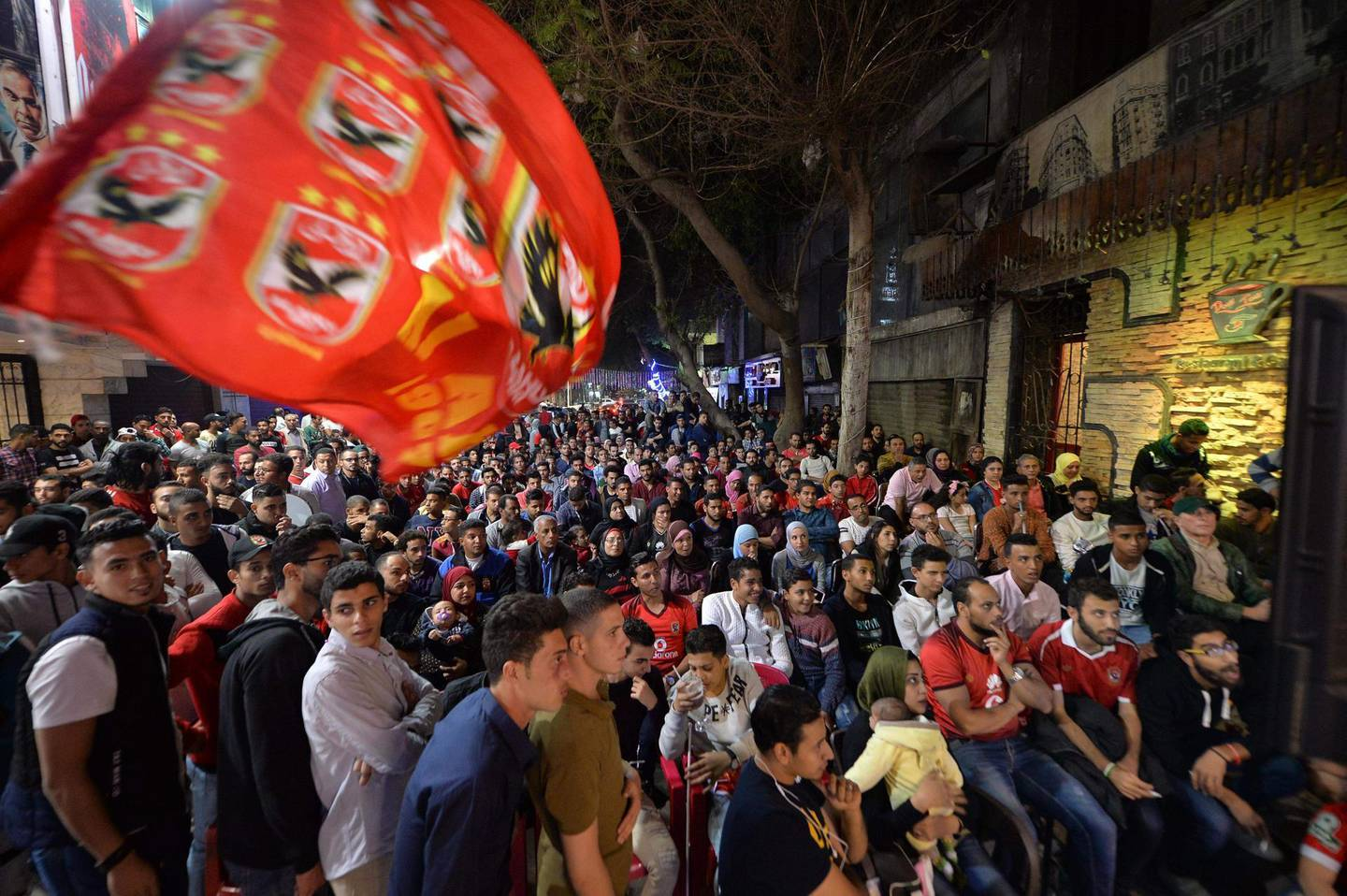 Egyptian Al-Ahly fans watch the CAF Champions League second leg final football match between Egypt's Al-Ahly and Tunisia's ES Tunis on street televisions in Cairo on November 9, 2018. / AFP / -