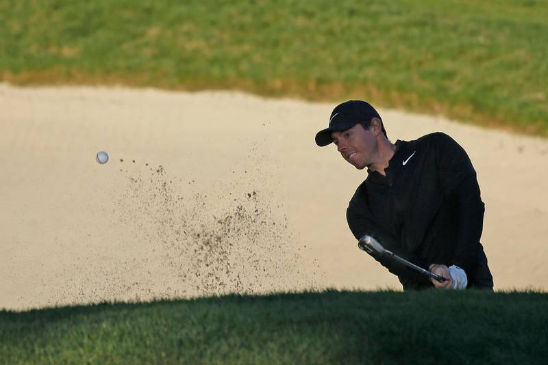 Rory McIlroy, of Northern Ireland, follows his shot out of a bunker up to the 10th green of the Monterey Peninsula Country Club Shore Course during the second round of the AT&T Pebble Beach National Pro-Am golf tournament Friday, Feb. 9, 2018, in Pebble Beach, Calif. (AP Photo/Eric Risberg)