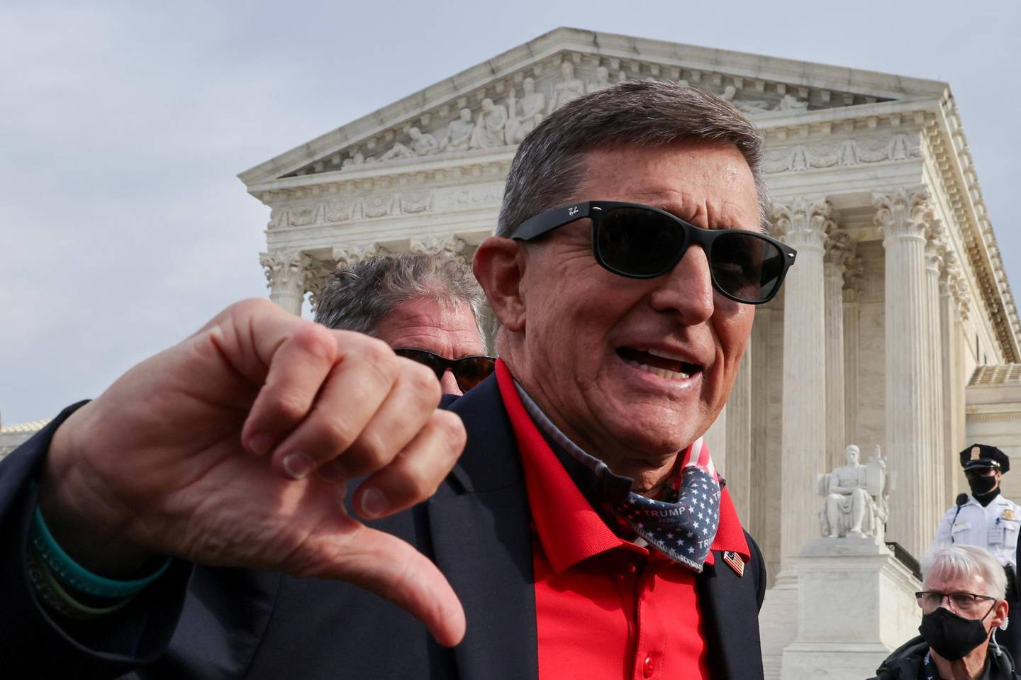 Former U.S. national security adviser Michael Flynn gestures as supporters of U.S. President Donald Trump rally to protest the results of the election in front of Supreme Court building, in Washington, U.S., December 12, 2020. REUTERS/Jonathan Ernst     TPX IMAGES OF THE DAY