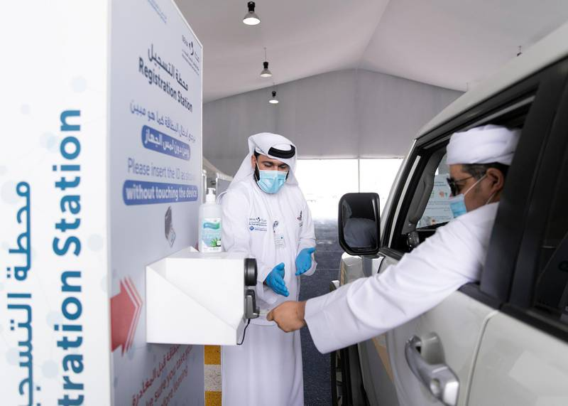 Ras Al Khaimah, UNITED ARAB EMIRATES. 30 APRIL 2020. A man uses his Emirates ID card to register before taking the test at SEHA's Ras Al Khaimah Covid-19 drive-through testing centre.(Photo: Reem Mohammed/The National)Reporter:Section: