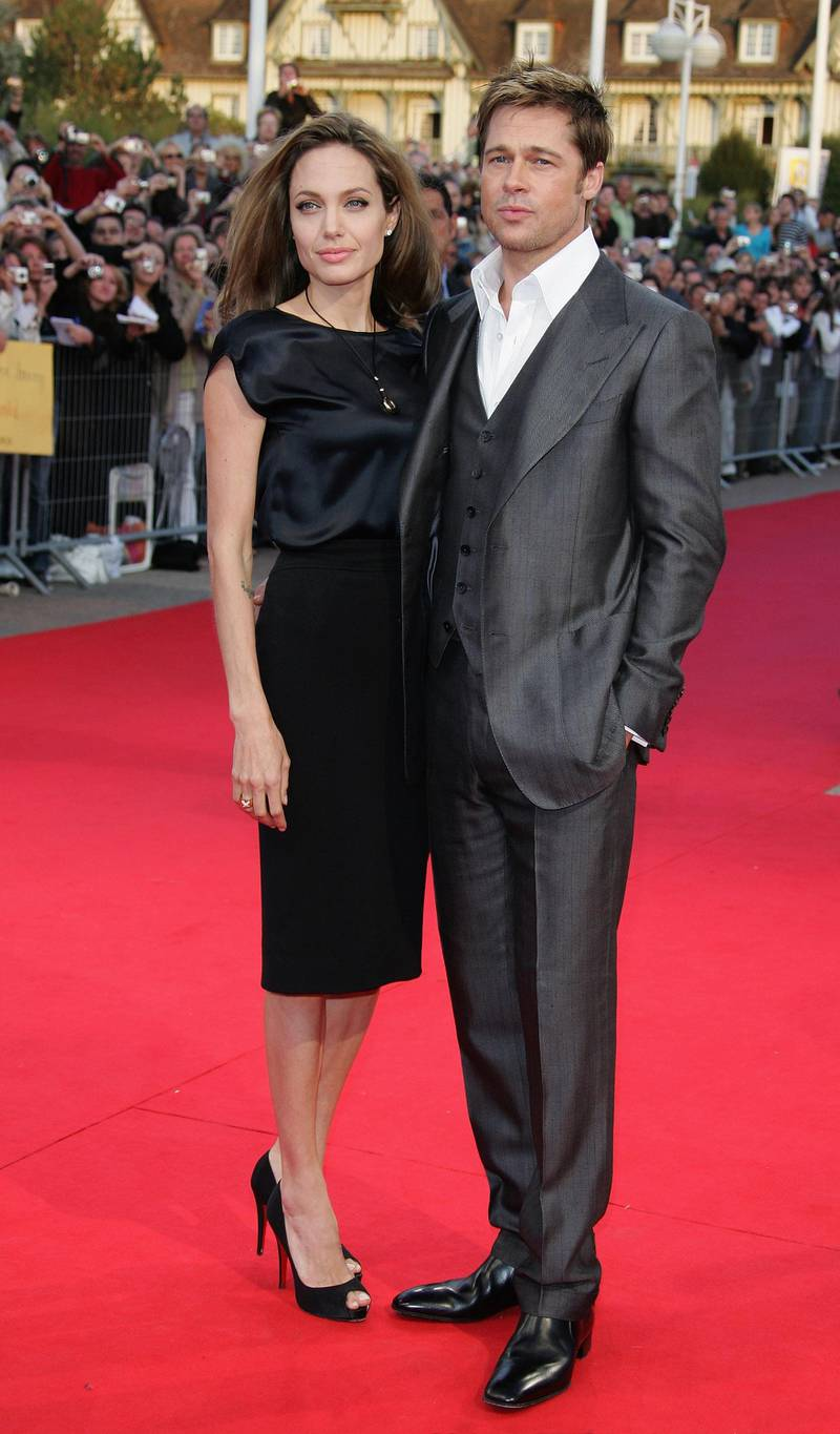 """DEAUVILLE, FRANCE - SEPTEMBER 03:  U.S actors Brad Pitt and his wife Angelina Jolie arrive for the premiere of """"The Assassination of Jesse James by the Coward Robert Ford"""" during the 33rd Deauville American Film Festival on September 03, 2007 in Deauville , France.  (Photo by Francois Durand/Getty Images)"""