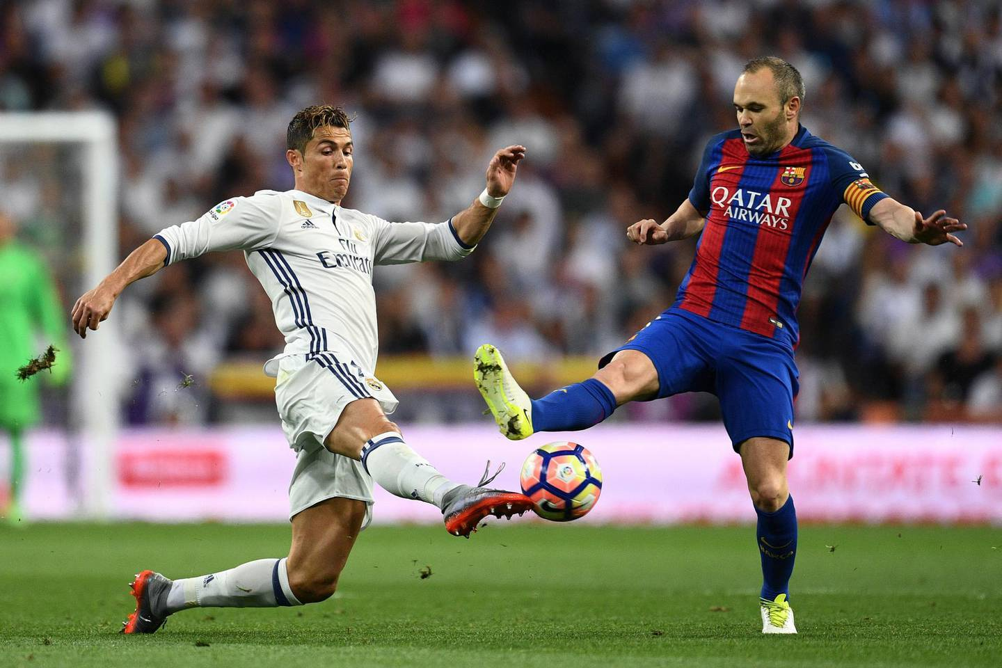 MADRID, SPAIN - APRIL 23:  Cristiano Ronaldo of Real Madrid and Andres Iniesta of Barcelona battle for the ball during the La Liga match between Real Madrid CF and FC Barcelona at Estadio Bernabeu on April 23, 2017 in Madrid, Spain.  (Photo by David Ramos/Getty Images)