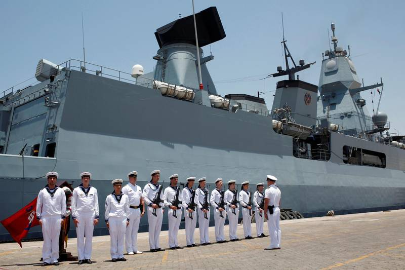 FILE PHOTO: German Navy armed personnel stand in front of the Frigate Hamburg, docked at Port Rashid, in Dubai May 26, 2013. REUTERS/Ahmed Jadallah/File Photo
