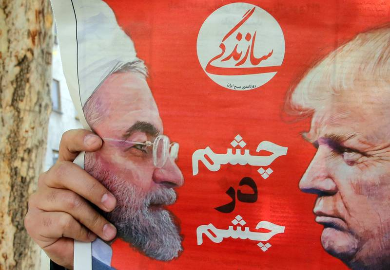 epaselect epa07493745 An Iranian man reads the Iranian daily newspaper 'Sazandegi' with a pictures of Iranian president Hassan Rouhani and US President Donald Trump on its front page and the title reading in Persian 'Eyes to Eyes',  next to a kiosk in Tehran, Iran, 09 April 2019. The US government on 08 April 2019 said it had designated Iran's revolutionary guards corps (IRGC) as a terrorist organization, marking the first time a US government has made such a designation on a foreign government's organization.  EPA/ABEDIN TAHERKENAREH