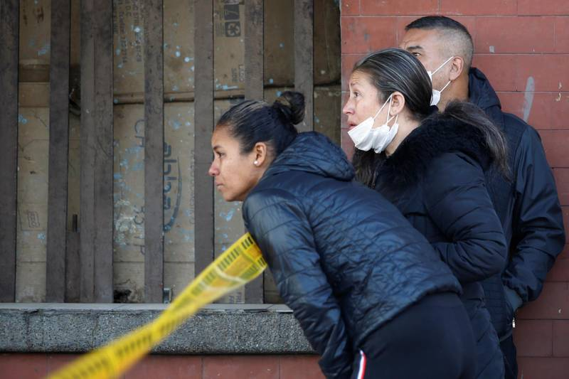 Relatives of prisoners are seen outside La Modelo prison, after a riot started by prisoners demanding government health measures against the spread of the coronavirus disease (COVID-19) in Bogota, Colombia March 22, 2020. REUTERS/Leonardo Munoz. NO RESALES. NO ARCHIVES.