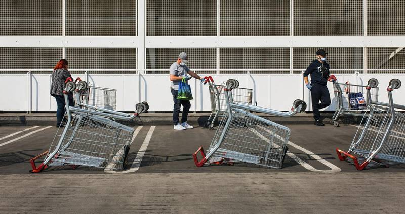 Upside down worldWallington, London SuburbsIt was the first time since the official lockdown I'd been able to visit the supermarket so the the queuing outside was all new to me. I was expecting things to be quite manic but everyone just calmly queued, keeping social distance. The overturned shopping trolleys really captured my eye and seemed to say something of this unusual situation. Photo by Michaela Strivens