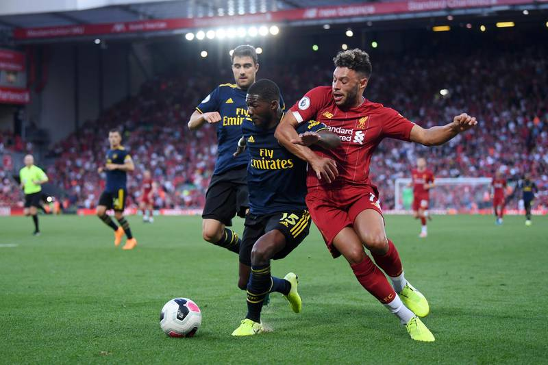 LIVERPOOL, ENGLAND - AUGUST 24: Ainsley Maitland-Niles of Arsenal and Alex Oxlade-Chamberlain of Liverpool battle for possession during the Premier League match between Liverpool FC and Arsenal FC at Anfield on August 24, 2019 in Liverpool, United Kingdom. (Photo by Laurence Griffiths/Getty Images)