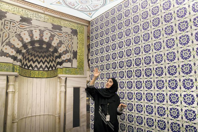 """ABU DHABI, UNITED ARAB EMIRATES - DEC 19, 2017Ameena Al Hammadi, Tourist Guide at Sheikh Zayed Grand Mosque Center (SZGMC), gives a tour of """"Hajj: Memories of a Journey"""" exhibition at the mosque.(Photo by Reem Mohammed/The National)Reporter: Roberta PenningtonSection: NA"""