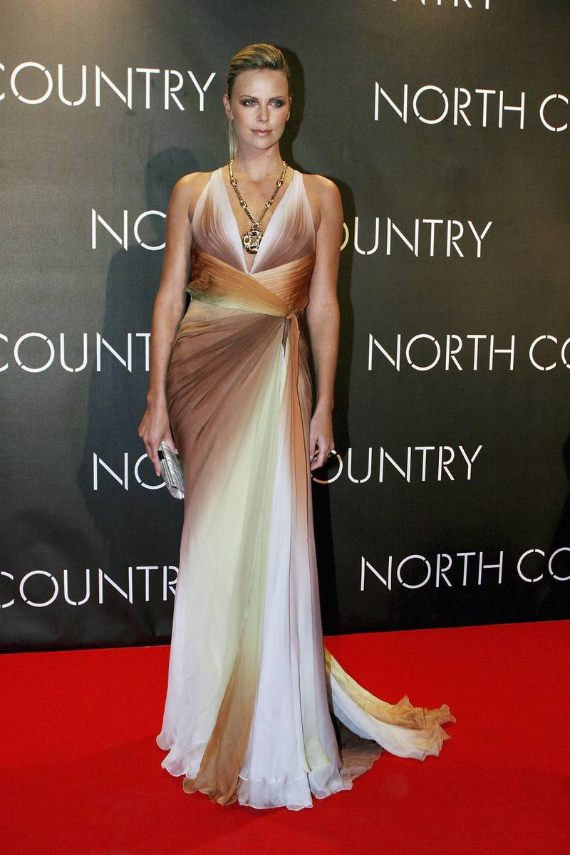 """ROME, ITALY - FEBRUARY 6:  Actress Charlize Theron (dressed by Versace) arrives at the Italian premiere for """"North Country"""" at the Warner Village Moderno Cinema on February 6, 2006 in Rome, Italy. (Photo by Franco Origlia/Getty Images)"""