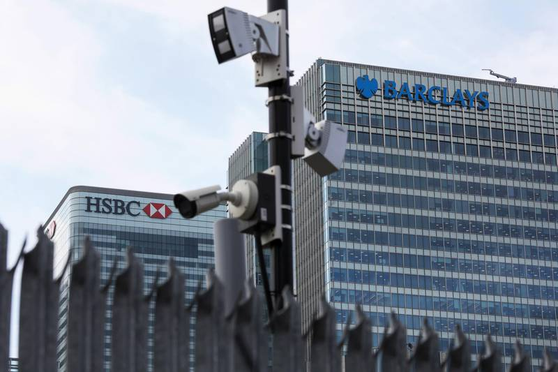 A security camera sits in view of the offices of HSBC Holdings Plc, left, and Barclays Plc, right, in the Canary Wharf business, financial and shopping district in London, U.K., on Thursday, June 5, 2018. The owners of a Canary Wharf skyscraper leased to Citigroup Inc. are seeking to refinance the 661 million-pound ($882 million) loan used to buy it five years ago, two people with knowledge of the plan said. Photographer: Chris Ratcliffe/Bloomberg
