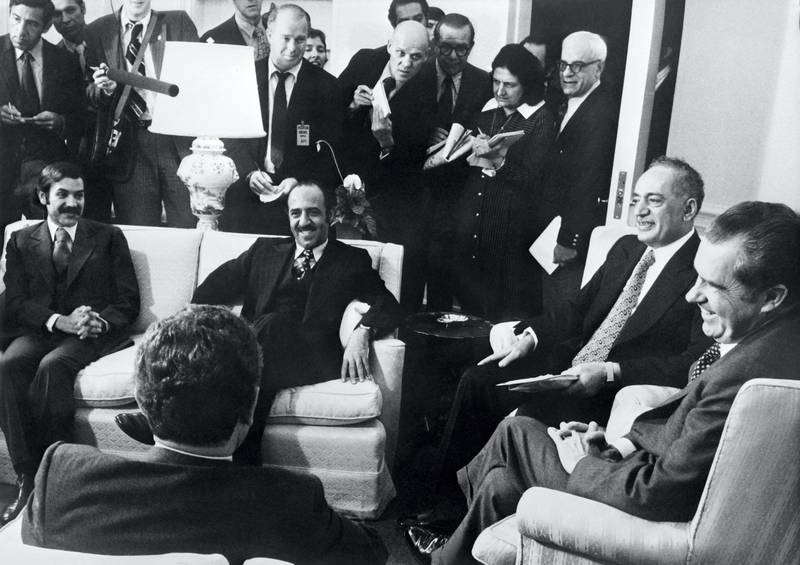 US President Richard Nixon (R) and Secretary of State of United States Henry Kissinger (back view) meet about the crisis in the Middle East with Arab Foreign Ministers (from left to right): Abdelaziz Bouteflika (Algeria), Sabah al-Ahmad al-Jaber al-Sabah (Kuwait), Omar Saqqaf (Saudi Arabia) on October 17, 1973 at the White House Oval Office in Washington, United States. (Photo by - / CONSOLIDATED / AFP)