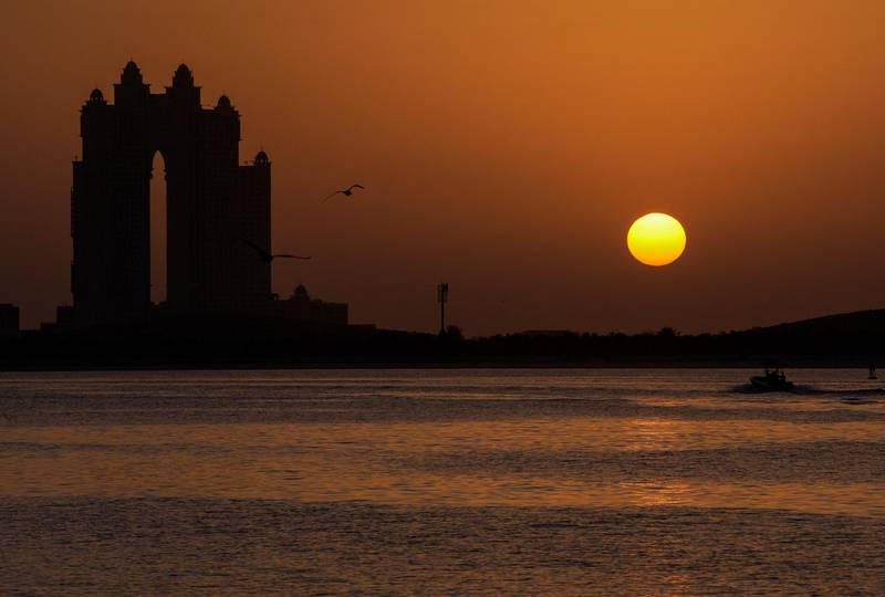 Abu Dhabi, United Arab Emirates, January 30, 2021.  Abu Dhabi residents enjoy the sunset along the Corniche on a Saturday evening.Victor Besa/The National For:  Stand alone/Stock Images