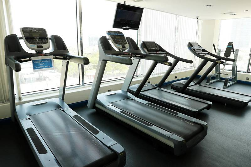 DUBAI, UNITED ARAB EMIRATES , July 8 – 2020 :- View of the Gym at the Towers Rotana hotel on Sheikh Zayed road in Dubai. After each use, cleaning staff disinfect these machines as a preventive measure against the spread of coronavirus and safe sticker pasted on the machine. (Pawan Singh / The National) For News/Standalone/Online/Stock