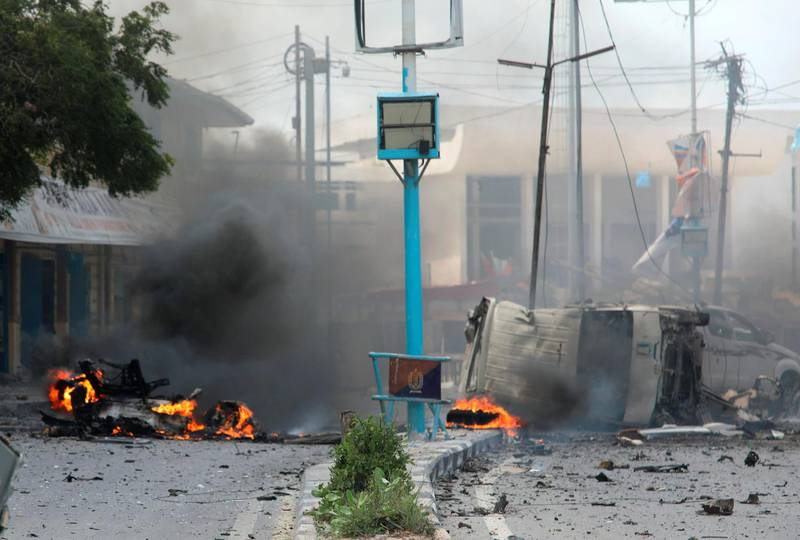Destroyed vehicles are seen at the scene of a suicide car bombing near Somalia's presidential palace in Mogadishu, Somalia July 7, 2018. REUTERS/Feisal Omar