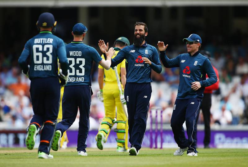 LONDON, ENGLAND - JUNE 13:  Moeen Ali of England celebrates with his teammates after dismissing Tim Paine of Australia during the 1st Royal London ODI match between England and Australia at The Kia Oval on June 13, 2018 in London, England.  (Photo by Jordan Mansfield/Getty Images)