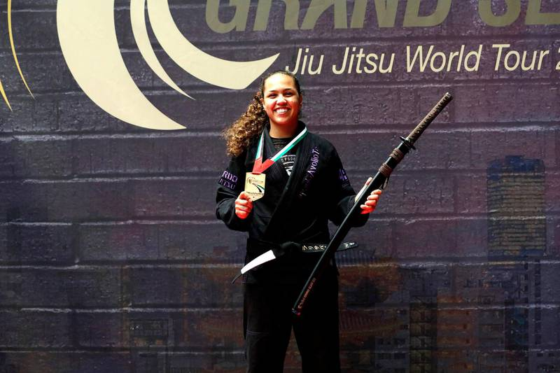 """The caption can be: """"Larissa Paes, the Abu Dhabi-based Brazilian jiu-jitsu instructor, is pleased to get her bid to remain world No 1 off to a winning start in Tokyo on Sunday. UAEJJF"""