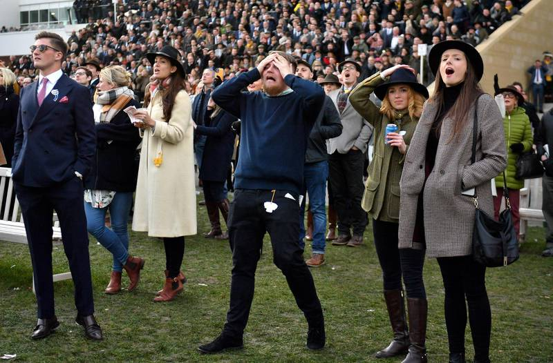 PA via Reuters Racegoers react after the Martin Pipe Conditional Jockeys' Handicap Hurdle during day four of the Cheltenham Festival at Cheltenham Racecourse.