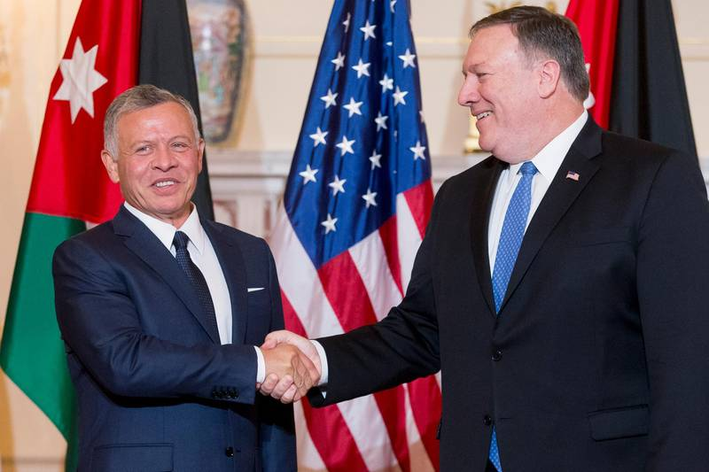 epa06831498 US Secretary of State Mike Pompeo (R) and King Abdullah II of Jordan shake hands during a photo opportunity for members of the news media before their working luncheon at the State Department in Washington, DC, USA, 22 June 2018.  EPA/MICHAEL REYNOLDS