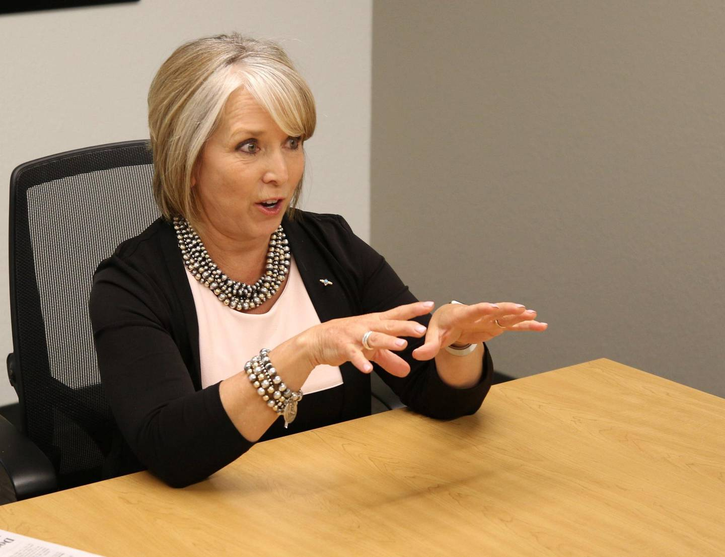 Gov. Michelle Lujan Grisham, who pushed for an immediate increase in the minimum wage in New Mexico to $10 an hour, has said some unintended consequences of the new law may make it necessary for lawmakers to revisit the issue at some point.FMN Minwage folo2 1216