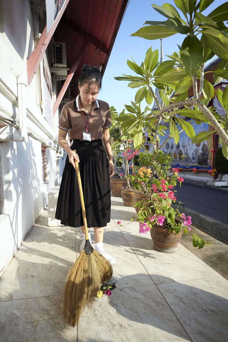 Bangkok-Thailand-CLC (Community Learning Center) Temple of Dawn- One student are sweeping the floor in front of the school.  Sasamon Rattanalangkarn for The National