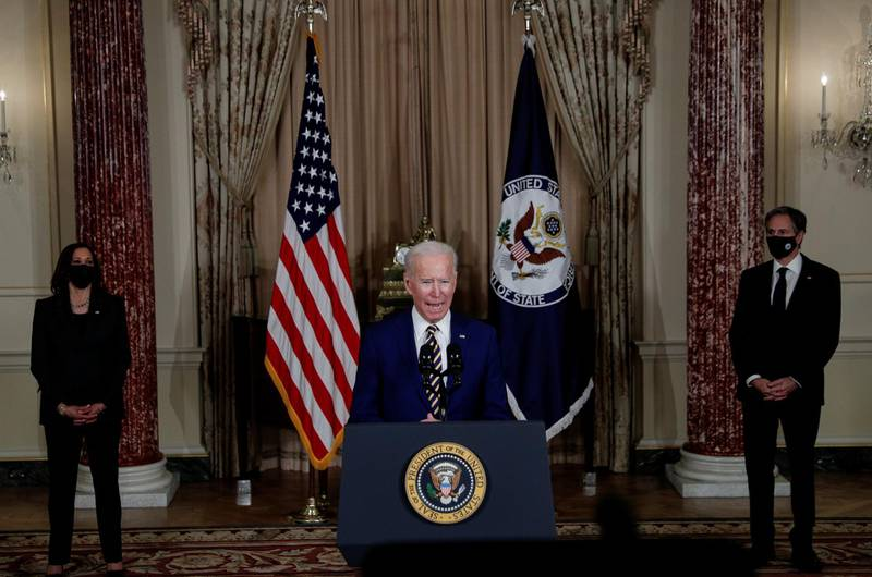 U.S. President Joe Biden delivers a foreign policy address as Vice President Kamala Harris and Secretary of State Antony Blinken listen during a visit to the State Department in Washington, U.S., February 4, 2021. REUTERS/Tom Brenner