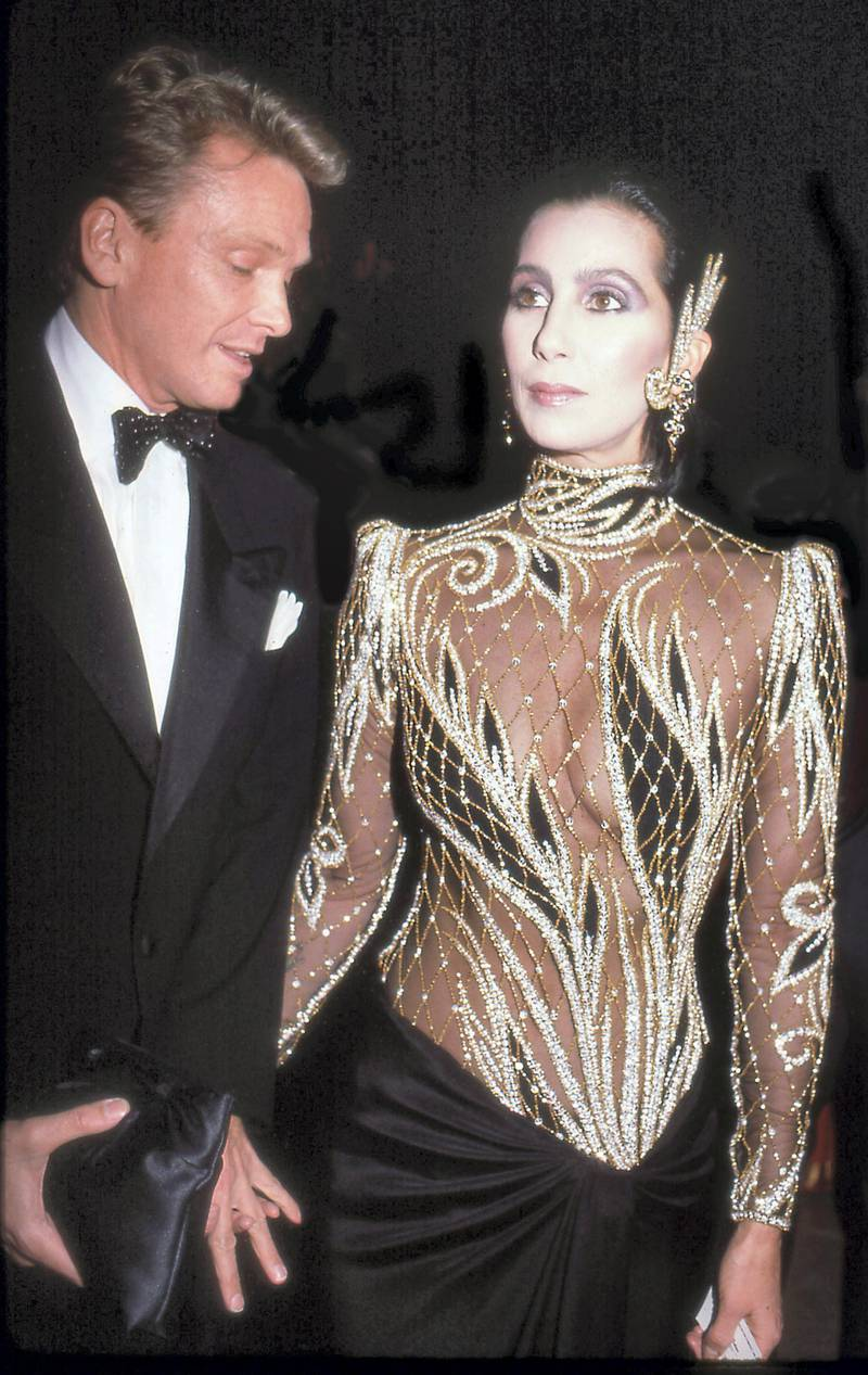 Designer Bob Mackie and the singer and actress Cher attend the Costume Institute Gala at the Metropolitan Museum of Art, New York, New York, 1985. (Photo by Rose Hartman/Getty Images)