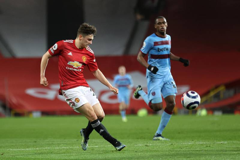 MANCHESTER, ENGLAND - MARCH 14: Daniel James of Manchester United crosses the ball during the Premier League match between Manchester United and West Ham United at Old Trafford on March 14, 2021 in Manchester, England. Sporting stadiums around the UK remain under strict restrictions due to the Coronavirus Pandemic as Government social distancing laws prohibit fans inside venues resulting in games being played behind closed doors. (Photo by Clive Brunskill/Getty Images)