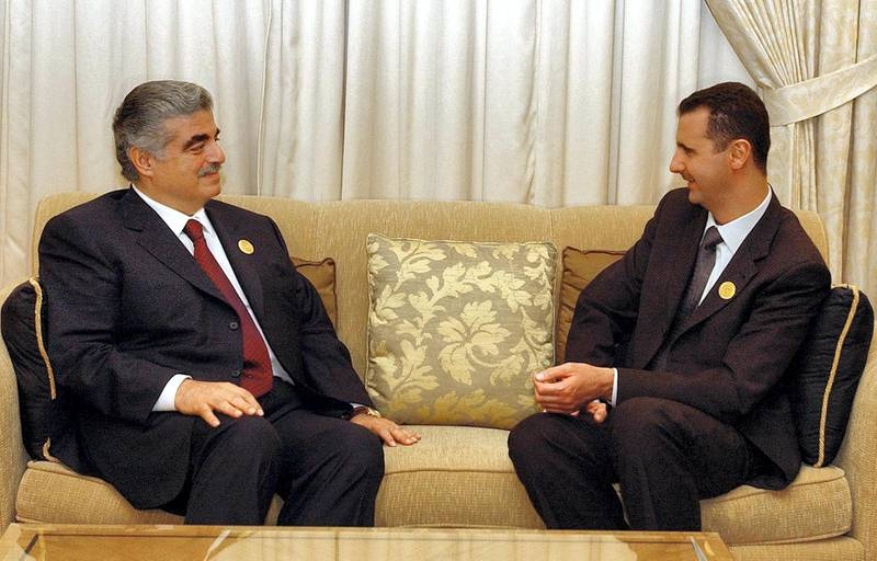 Lebanese Prime Minister Rafiq Hariri (L) meets with Syrian President Bashar al-Assad on the sidelines of the Arab summit in Beirut 27 March 2002. Hariri announced that the Palestinians would rejoin the summit 28 March after pulling out over Lebanon's refusal to allow Palestinian leader Yasser Arafat to address the meeting by satellite link.       AFP PHOTO/Ayman TRAWI/HO (Photo by AYMAN TRAWI / LEBANESE PRIME MINISTER'S OFFICE / AFP)