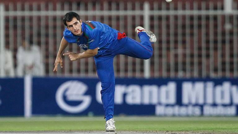 An image that illustrates this article Afghanistan's cricket win brings joy to millions in nation's darkest hour