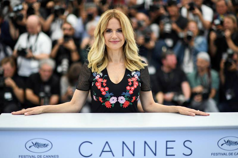 """US actress Kelly Preston poses on May 15, 2018 during a photocall for the film """"Gotti"""" at the 71st edition of the Cannes Film Festival in Cannes, southern France. (Photo by Loic VENANCE / AFP)"""