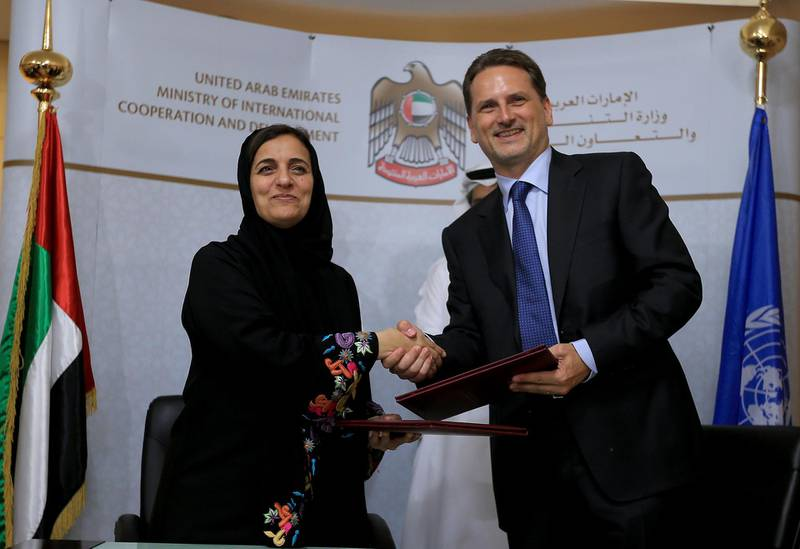 ABU DHABI - UNITED ARAB EMIRATES - 21JULY2014 - Shaikha Lubna Bint Khalid Al Qasimi, Minister of International Cooperation & Development and Head of the National Committee for the Coordination of Foreign Aid and Pierre Krahenbuhl, Commissioner General of UNRWA, shake hands after signing an agreement in which UAE is providing the UNRWA with AED 55 million for the benefit of 361,300 Palestinian victims, representing 92,200 displaced Palestinian families inside Syria, in the presences of Mohamed Saif Al Suwaidi (behind left) the Director General of Abu Dhabi Fund for Development and Hazza Mohamed Al Qahtani, MICAD's Undersecretary yesterday at Ministry of International Cooperation and Development office in Abu Dhabi. Ravindranath K / The National (to go with Anwar story for News)