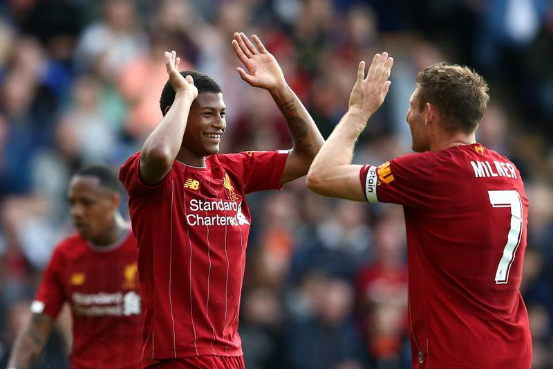BIRKENHEAD, ENGLAND - JULY 11: Rhian Brewster of Liverpool celebrates his goal with James Milner of Liverpool during the Pre-Season Friendly match between Tranmere Rovers and Liverpool at Prenton Park on July 11, 2019 in Birkenhead, England. (Photo by Jan Kruger/Getty Images)