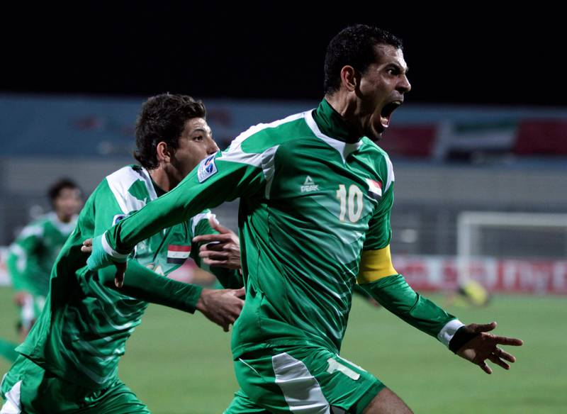 Iraq's Younus Mahmood, right, celebrates his goal against United Arab Emirates during the Gulf Cup final Friday, Jan. 18 , 2013, in Rifa, Bahrain. United Arab Emirates beat Iraq 2-1 in extra time on Friday to claim its second Gulf Cup title. (AP Photo/Hasan Jamali) *** Local Caption ***  Bahrain Gulf Cup.JPEG-04ca3.jpg
