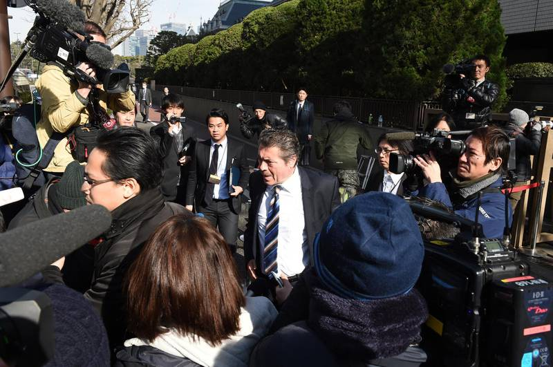 """Lebanon's Ambassador to Japan Nidal Yehya (C) leaves after a court hearing on the case of former Nissan chairman Carlos Ghosn at the Tokyo District Court in Tokyo on January 8, 2019. - Former Nissan boss Carlos Ghosn said on January 8 he had been """"wrongly accused and unfairly detained"""" at a high-profile court hearing in Japan, his first appearance since his arrest in November rocked the business world. (Photo by Kazuhiro NOGI / AFP)"""