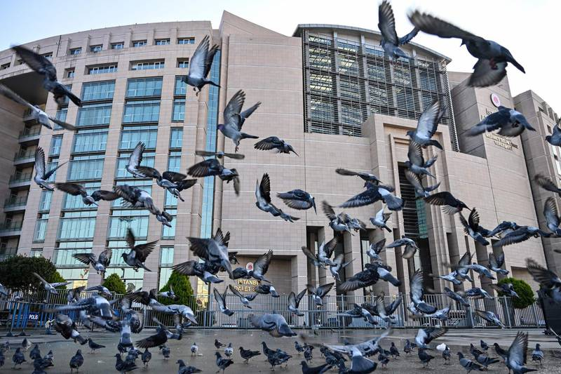 Ppigeons fly outside the courthouse in Istanbul on December 11, 2019 during the trial of Metin Topuz, an US consulate staffer accused of spying and attempting to overthrow the government.  Topuz, a Turkish citizen and liaison with the US Drug Enforcement Administration, was arrested in 2017 and has been accused of ties to US-based preacher Fethullah Gulen who Ankara says ordered a failed 2016 coup. / AFP / Ozan KOSE