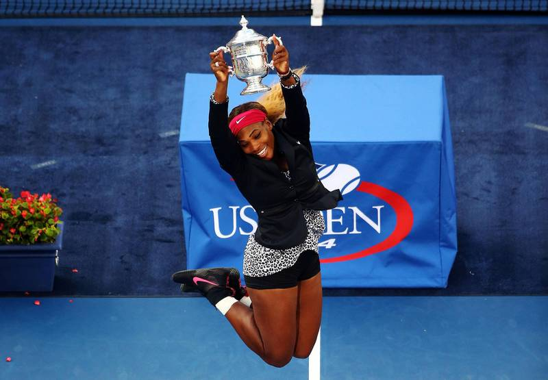 NEW YORK, NY - SEPTEMBER 07:  Serena Williams of the United States celebrates with the trophy after defeating Caroline Wozniacki of Denmark to win their women's singles final match on Day fourteen of the 2014 US Open at the USTA Billie Jean King National Tennis Center on September 7, 2014 in the Flushing neighborhood of the Queens borough of New York City. Williams defeated Wozniacki in two sets by a score of 6-3, 6-3.  (Photo by Streeter Lecka/Getty Images)