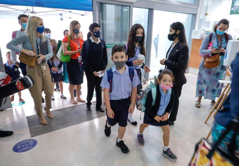 Abu Dhabi, United Arab Emirates, February 16, 2021.  Pupils return to school on Sunday at British School Al Khubairat.  --  Parents, teachers and students pass security before entering the school.Victor Besa/The NationalReporter:  Haneen DajaniSection:  NA