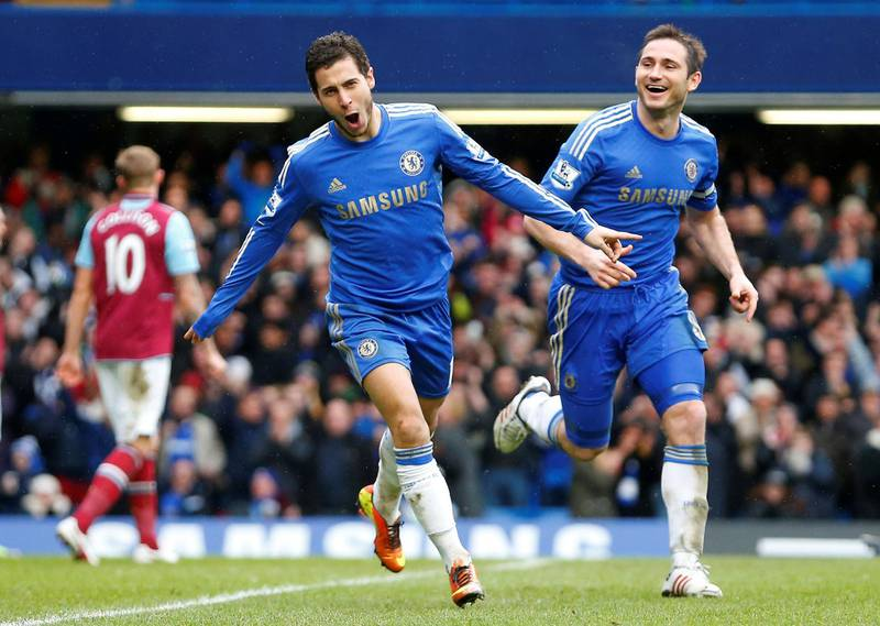 FILE PHOTO: Eden Hazard of Chelsea (L) celebrates scoring against West Ham next to team mate Frank Lampard during their English Premier League soccer match at Stamford Bridge in London, March 17, 2013.  REUTERS/Andrew Winning (BRITAIN)/File Photo