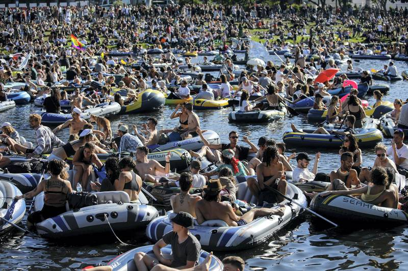 People attend a rave in boats of all sizes to give support to Berlin's world renowned dance clubs which are struggling due to coronavirus COVID-19 pandemic on the Landwehr canal on May 31, 2020 in Berlin's Kreuzberg district. (Photo by David GANNON / AFP)