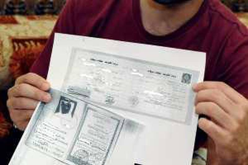 Abdullah, Yara's father, shows the copies of the identification papers provided by the government, at his house in Ahmadi , Kuwait on Feb.23, 2010. (Photo/Gustavo Ferrari/The National)